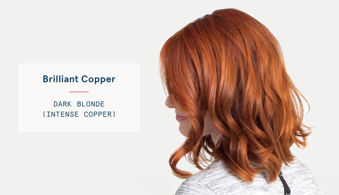 Image of woman with brilliant copper custom red hair color, she has dark blonde base with intense copper tones