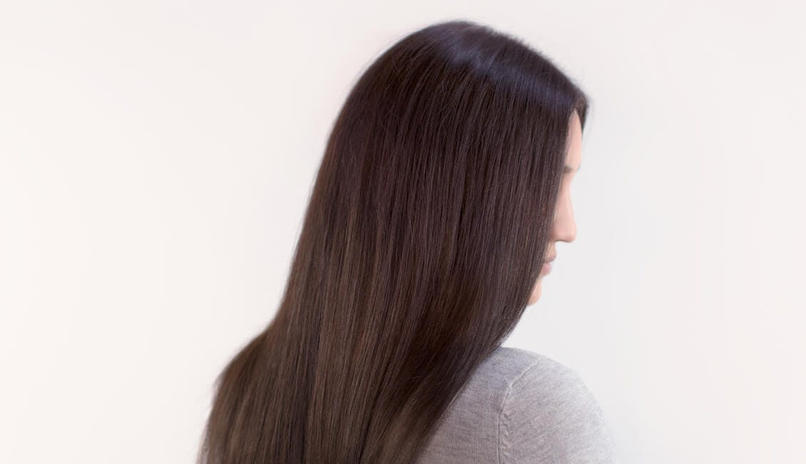 Image of esalon client Kathryn with custom cool iced chocolate hair color trending for winter