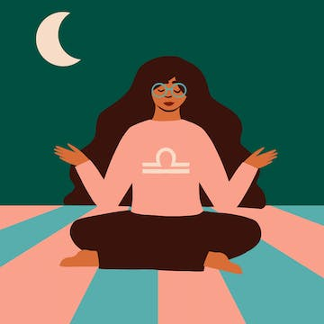 Libra woman with dark custom hair color meditating under the moon.