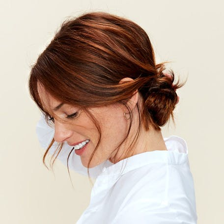 Image of esalon client sharon with an undone bun updo featured in this hair tutorial in color mastery