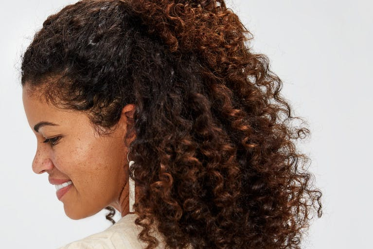 Image of esalon client Jailyn with half-up party style