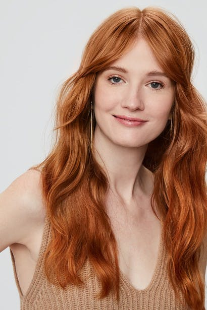 Image of esalon client dominique's custom dark blonde copper hair color