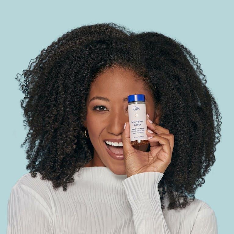 eSalon client holding her custom ammonia-free demi-permanent hair color