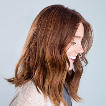 Image of woman with copper brunette custom esalon hair color trending for summer