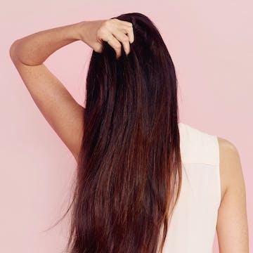 eSalon client with custom rich mahoganny brunette hair color.
