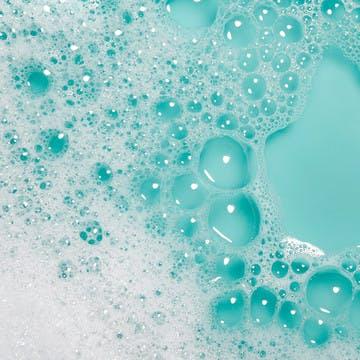 Image of shampoo suds on blue background