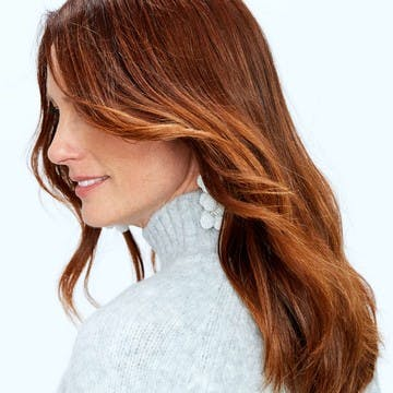 Image of an older eSalon client with vibrant copper hair color