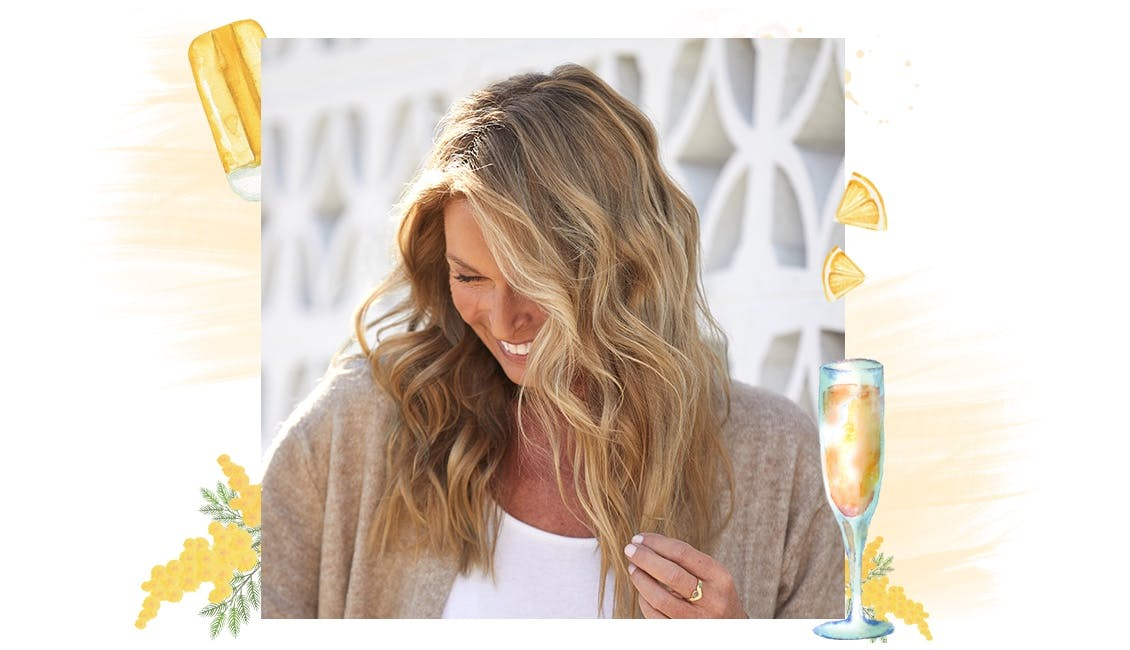 eSalon client in our Creamsicle Mimosa custom hair color with dark to medium blonde base and natural golden tones.