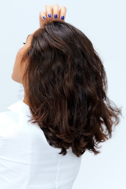 Image of esalon client chelsea with custom darkest brown hair color