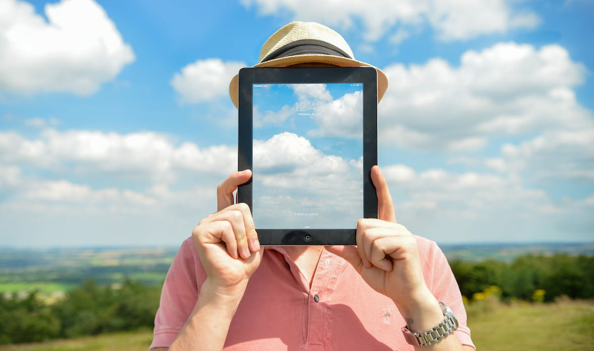 Transparency - man with clouds on table for face.
