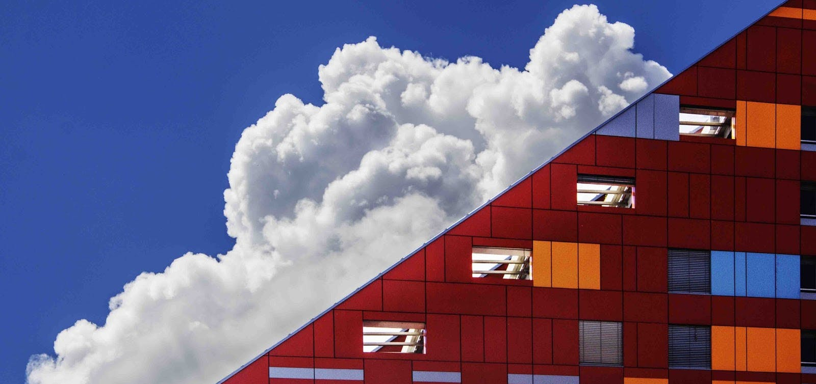 Building with clouds in background.