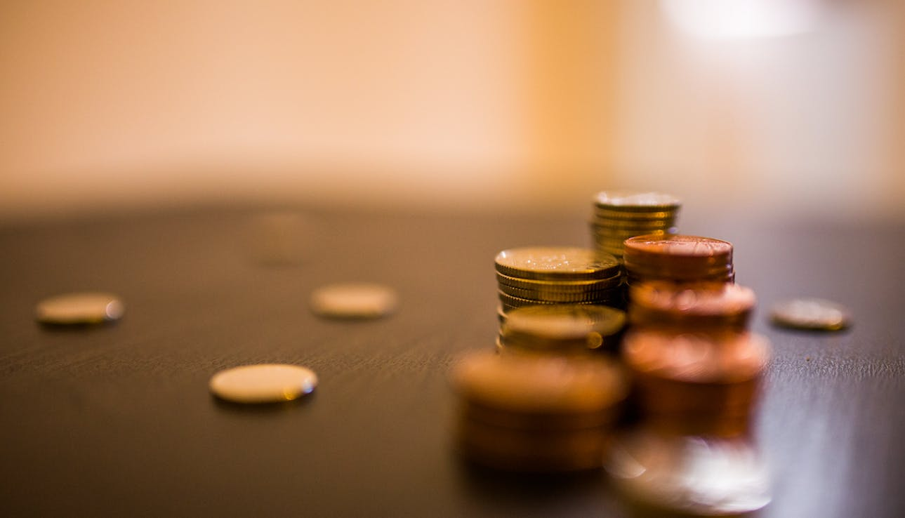 Coins on table - finance and file management.