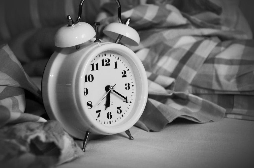 Black and white alarm clock - be on time to your coworking space.