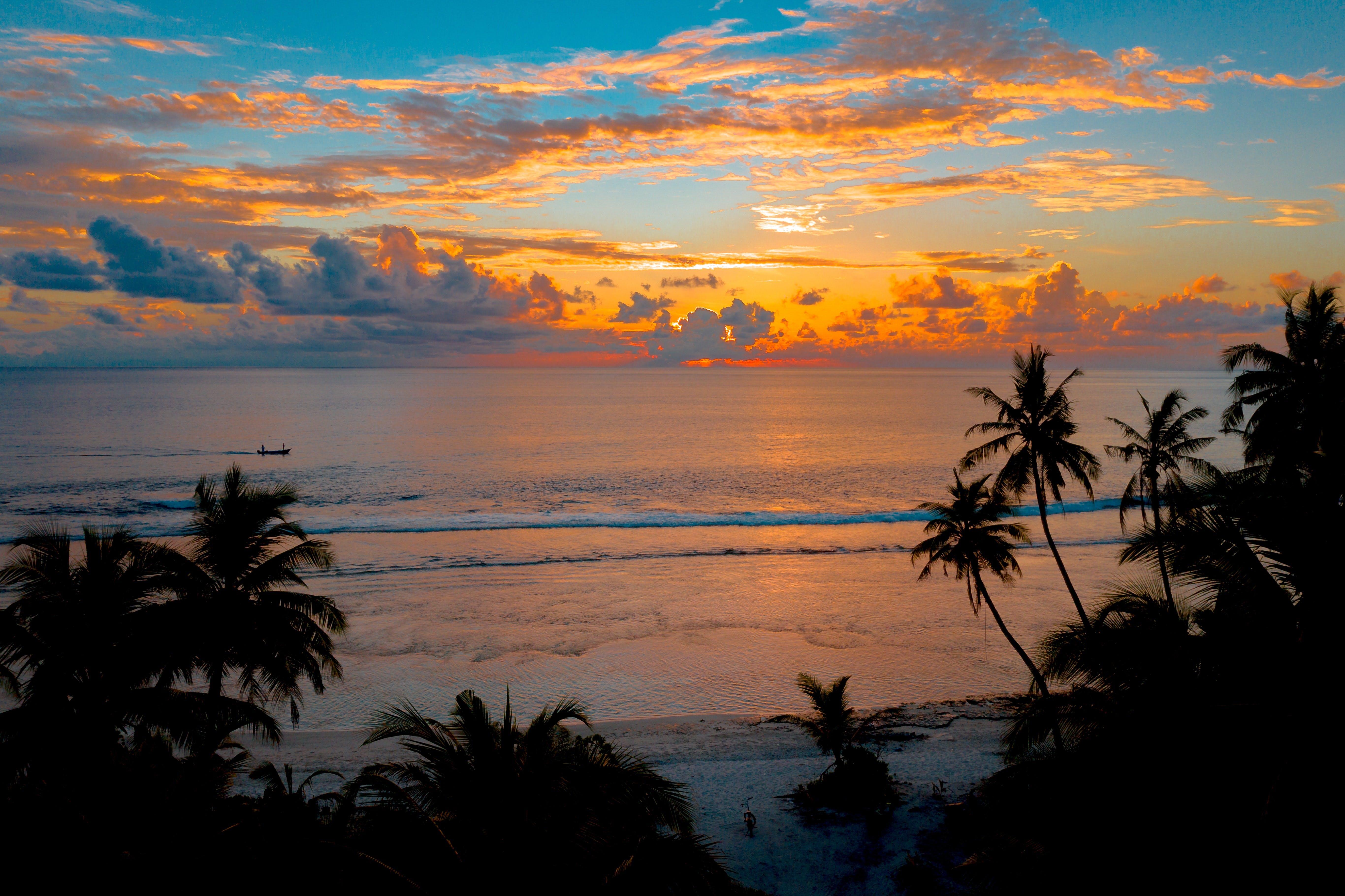 Island sunset over ocean.