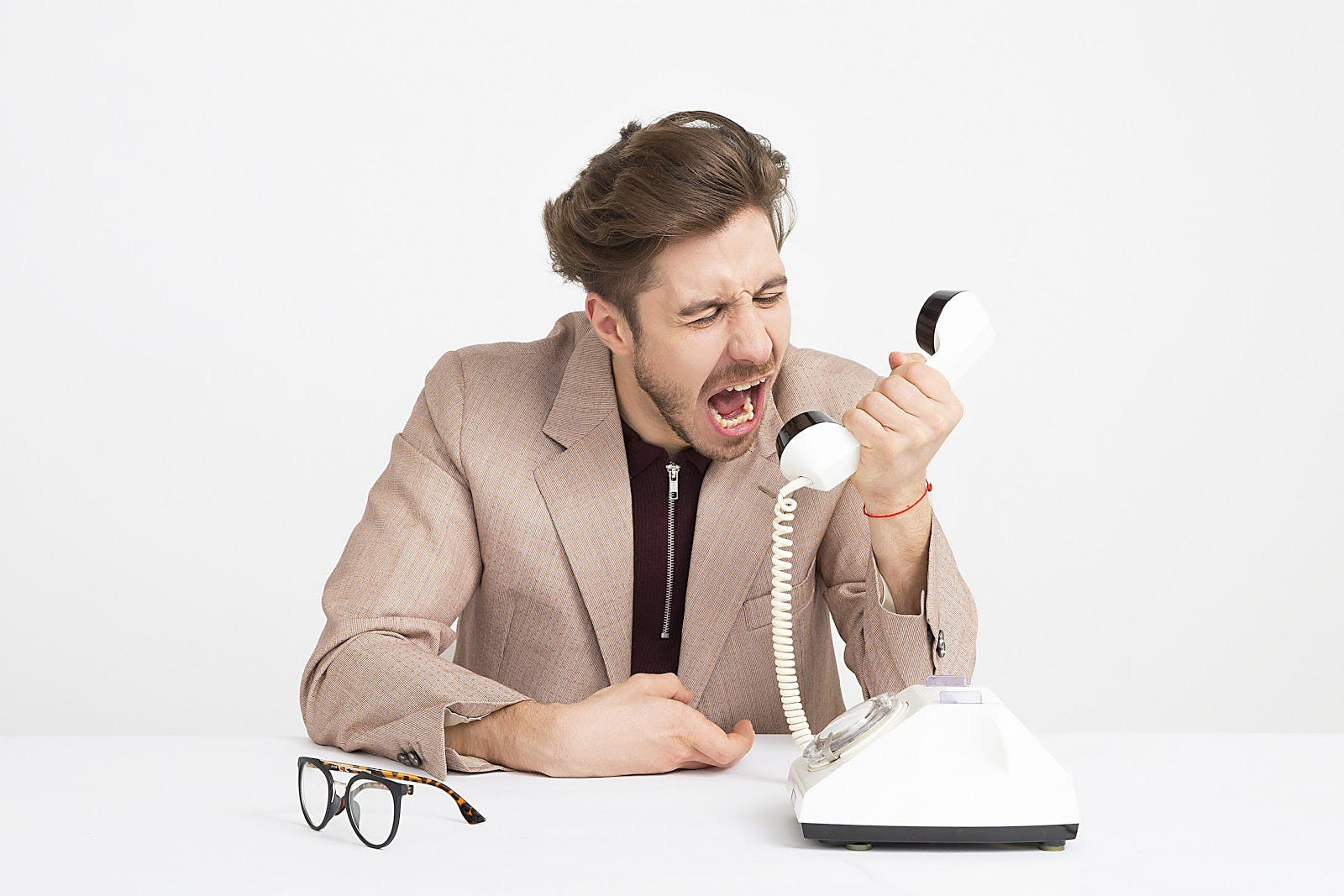 Person yelling into phone.