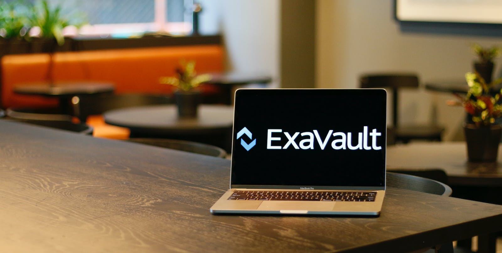 Laptop open showing logo for ExaVault SFTP file transfer service.
