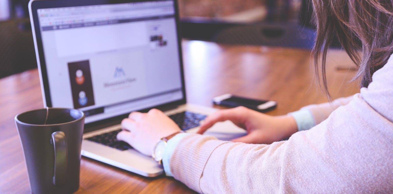 Customer using laptop for online file transfer.