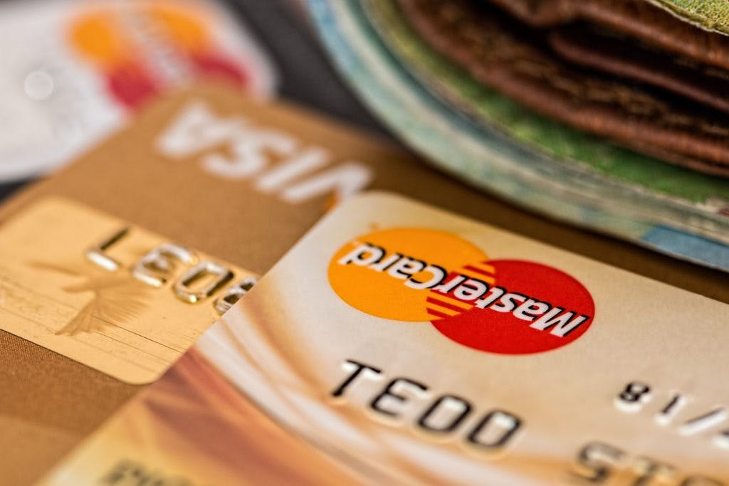 Credit card being used for retail e-commerce purchase.