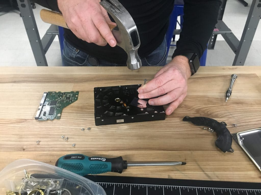 Removing hard drive compression mount.