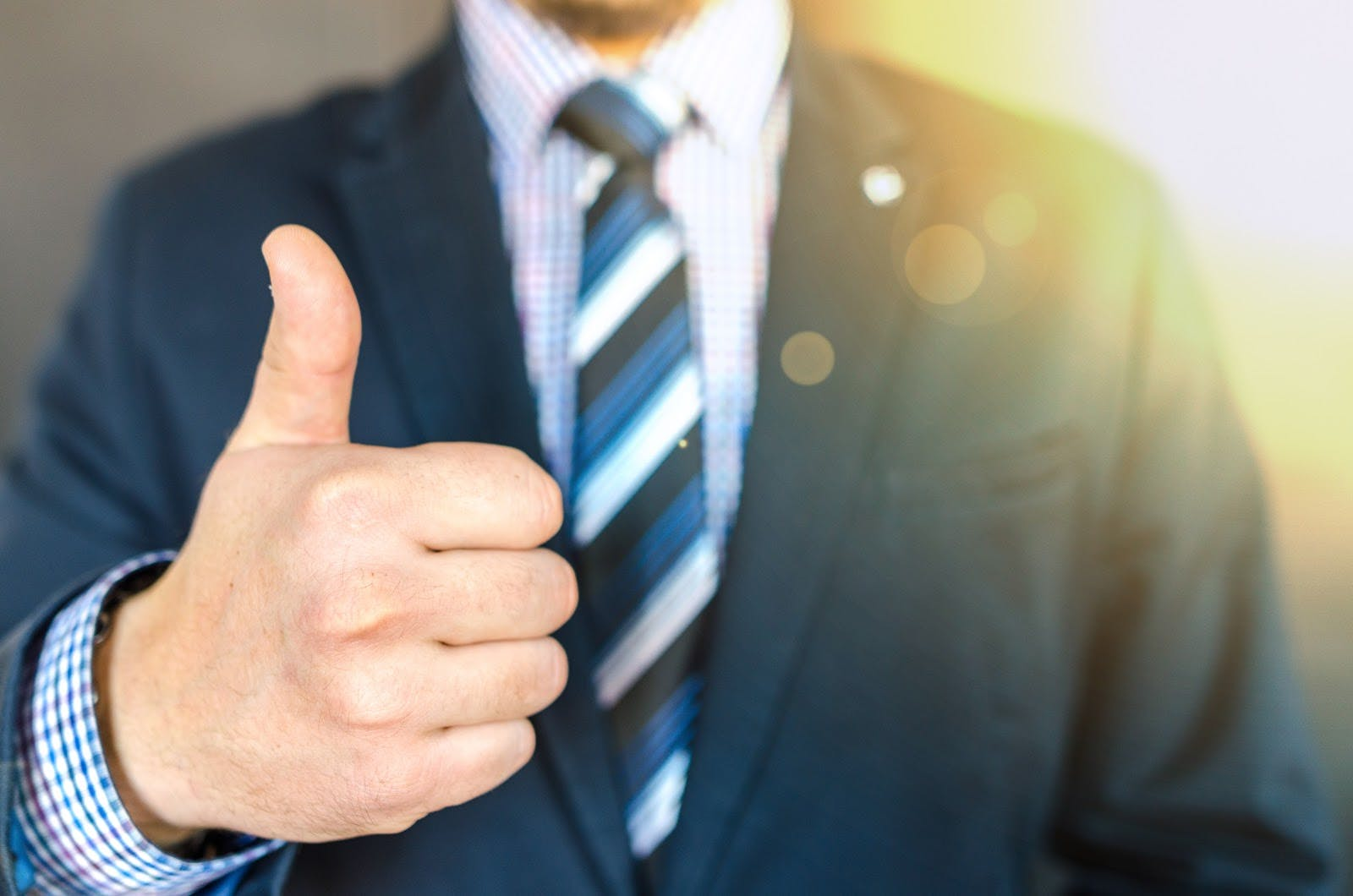 Thumbs up recognition of work.