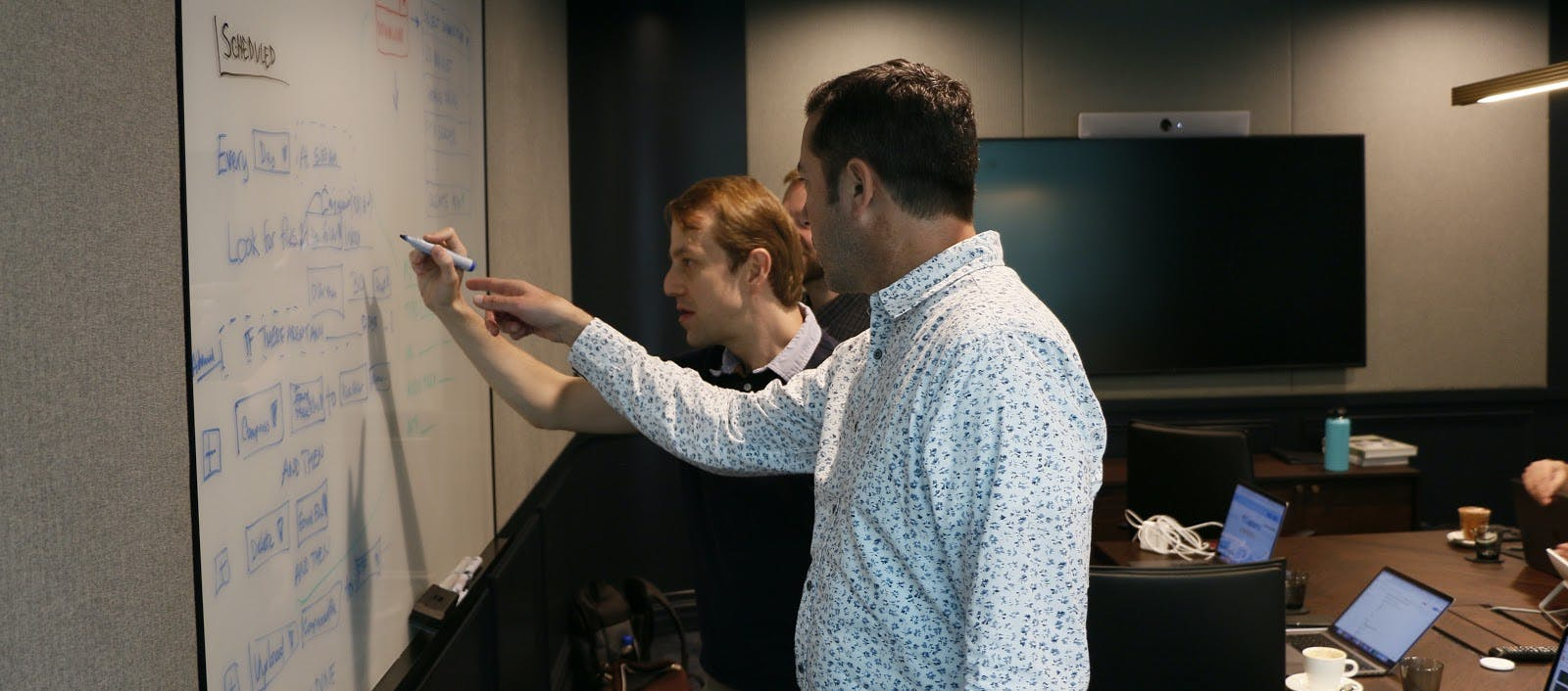 Two engineers working on product roadmap.