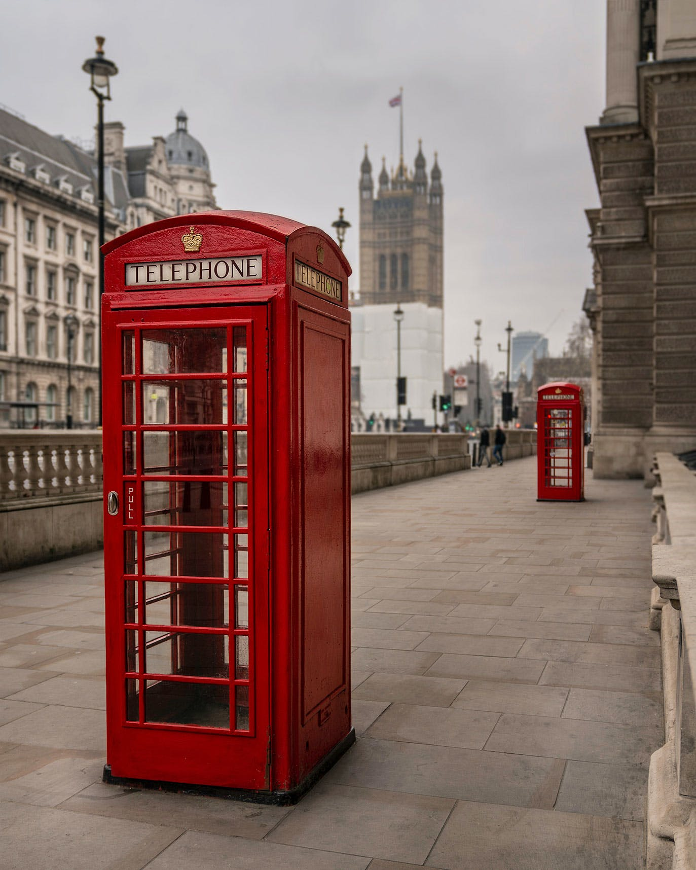 Red Telephone Box on Parliament Street view of The Palace of Westminster