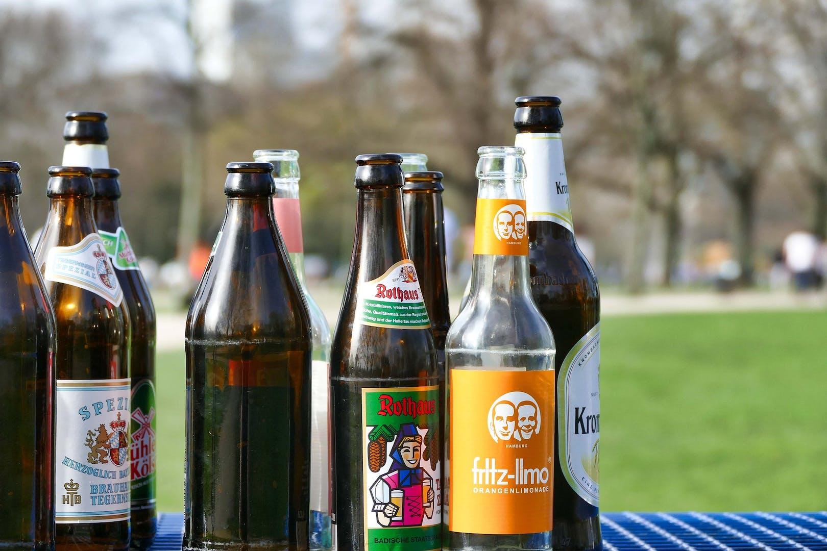 Random beer bottles arranged on a table.