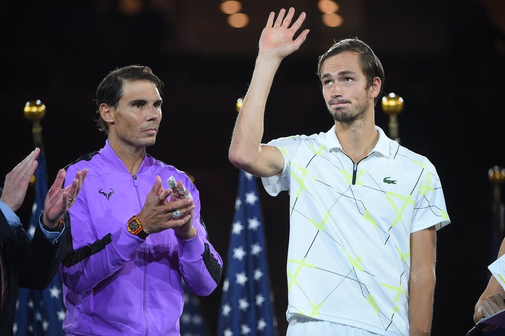 Daniil Medvedev wawing to the crowd on the podium at the 2019 US Open