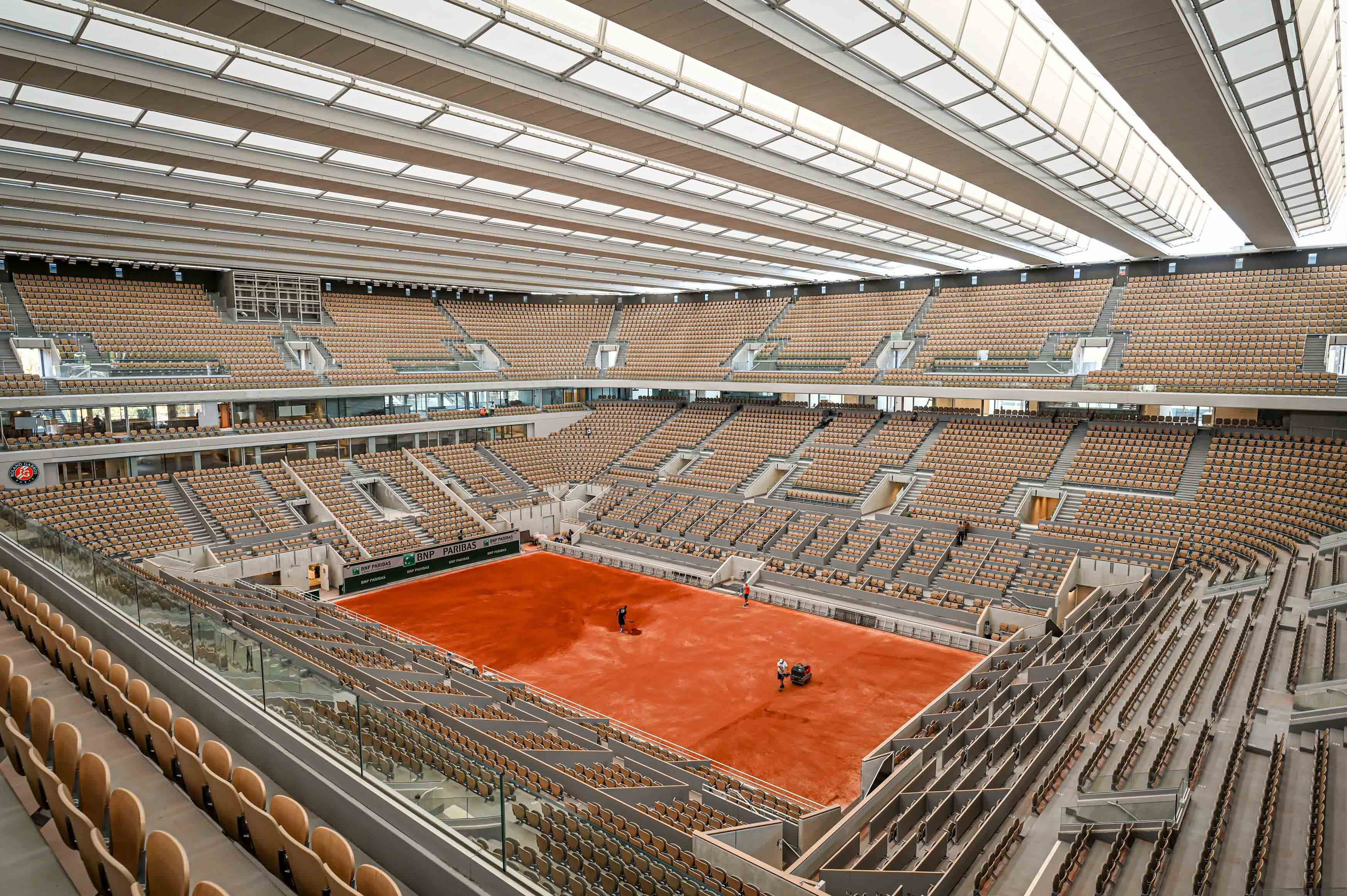Red clay being put on the new Philippe-Chatrier court September 2020