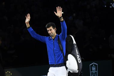 Novak Djokovic wawing to the crowd after his win at the Rolex Paris Masters 2019