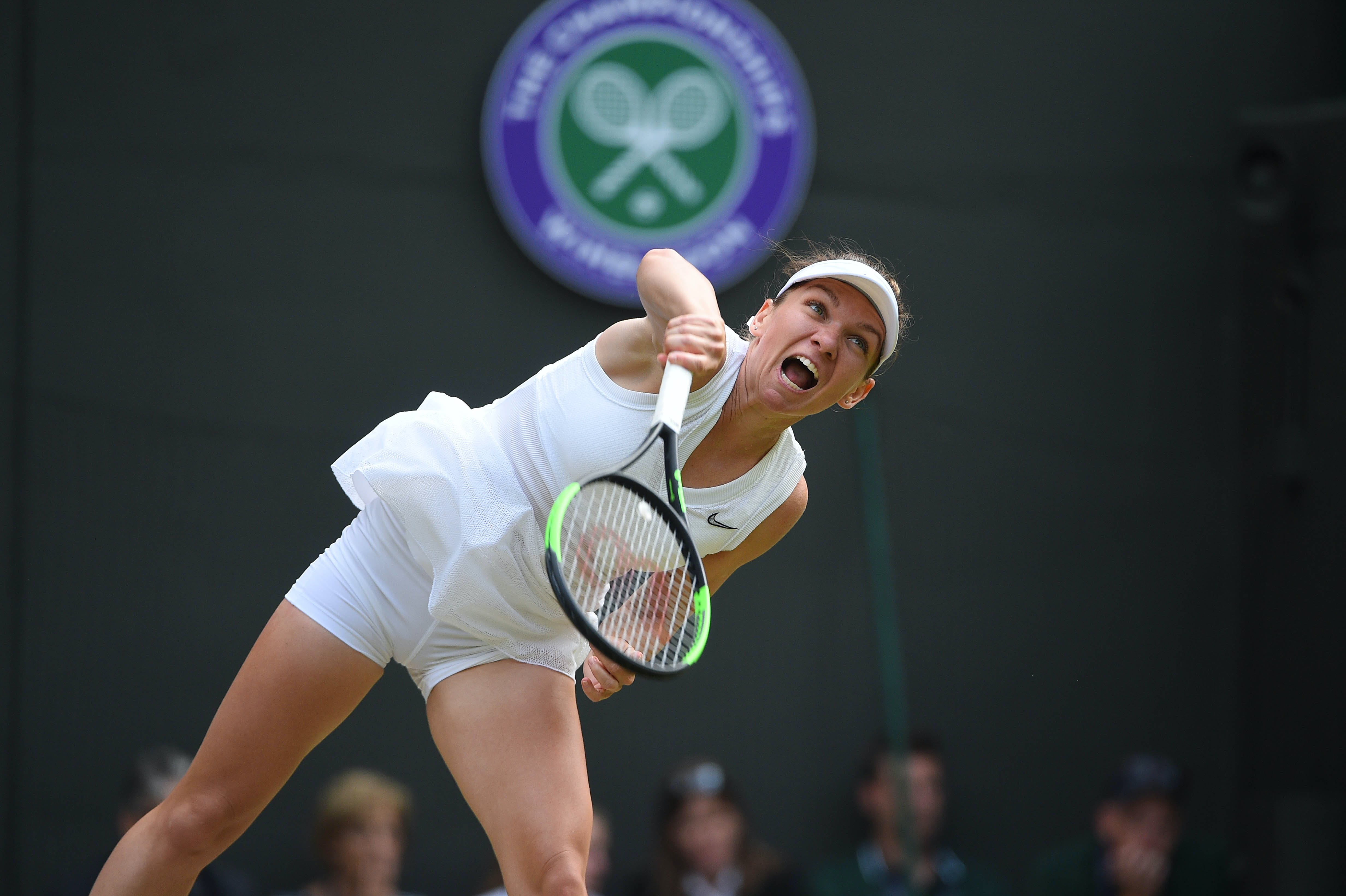 Simona Halep serving at Wimbledon 2019