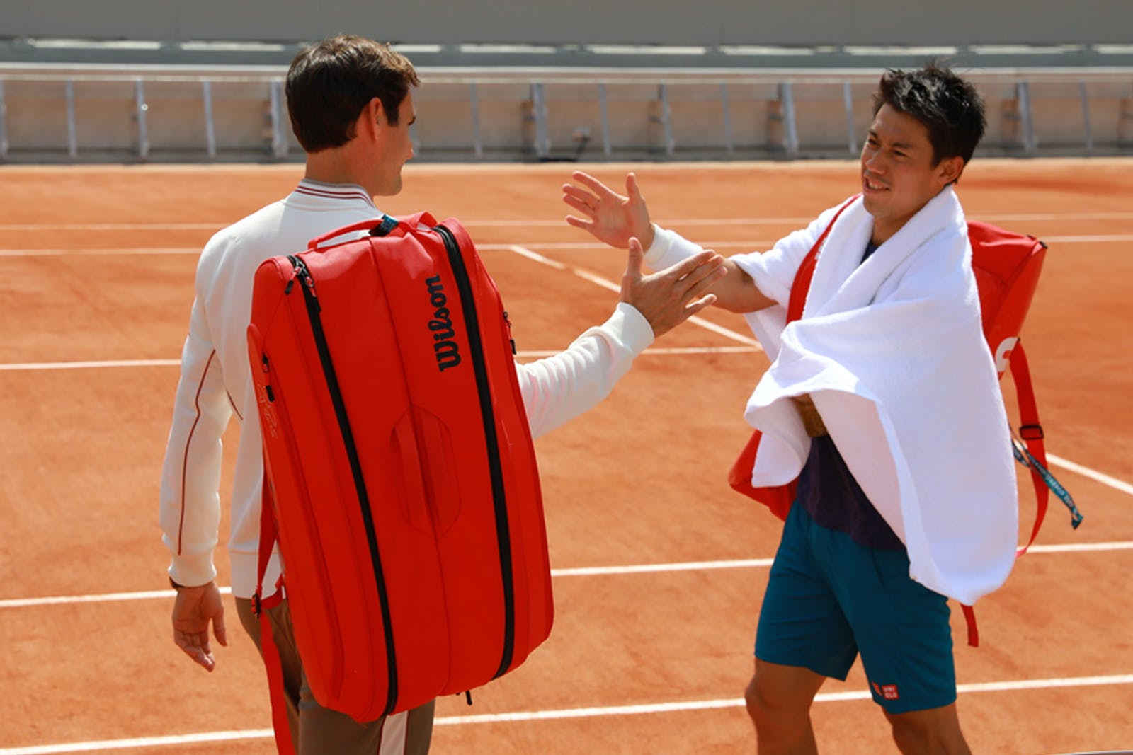 Roger Federer and Kei Nishikori practice