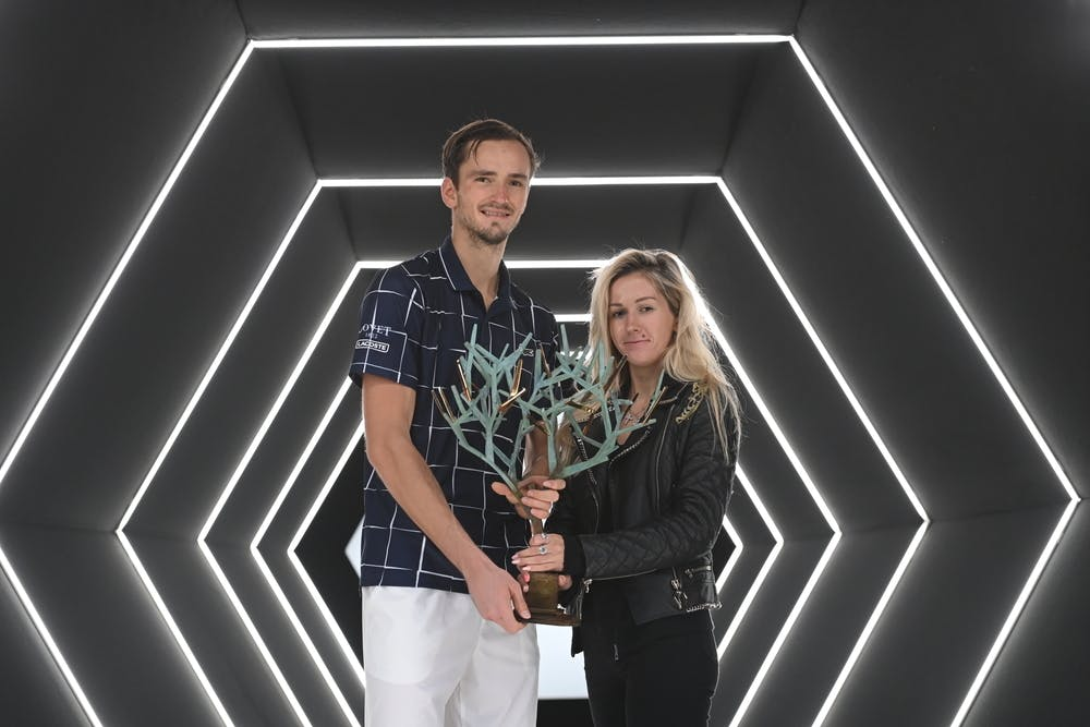 Daniil Medvedev and his wife Daria posing with the trophy at the Rolex Paris Masters 2020.