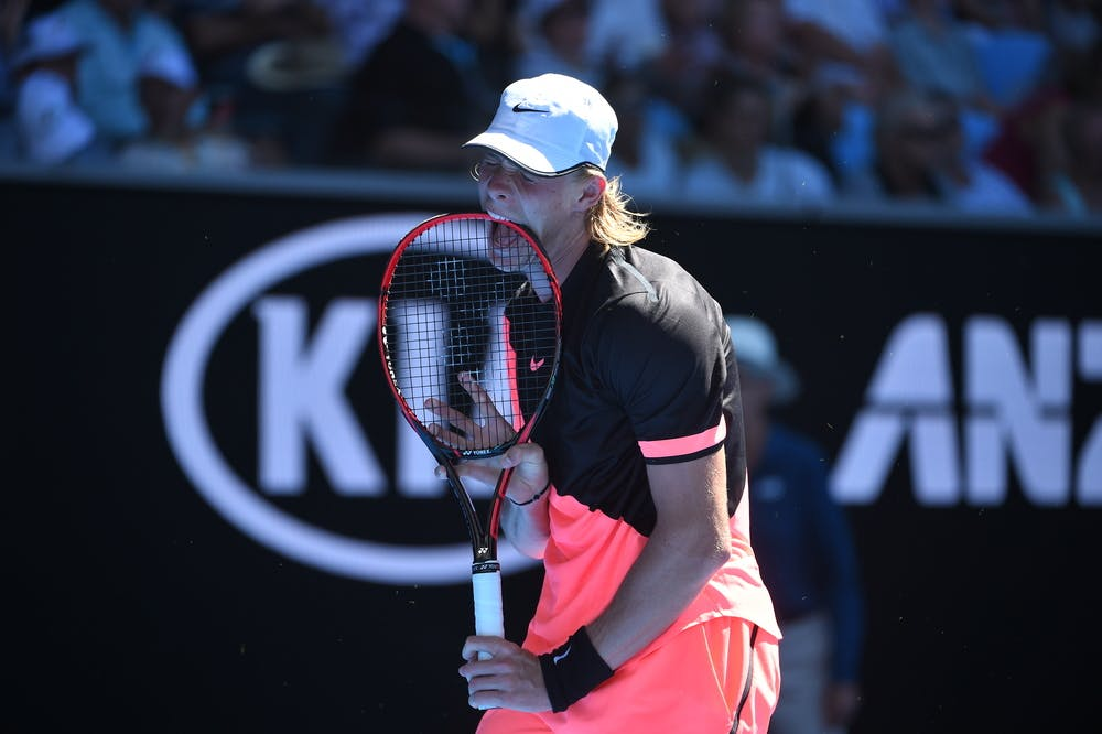 Denis Shapovalov biting his racket during the 2018 Australian Open