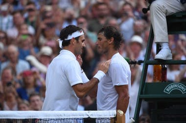 Rafael Nadal congratulates Roger Federer at the net after the Swiss won their semi final match-up at Wimbledon 2019