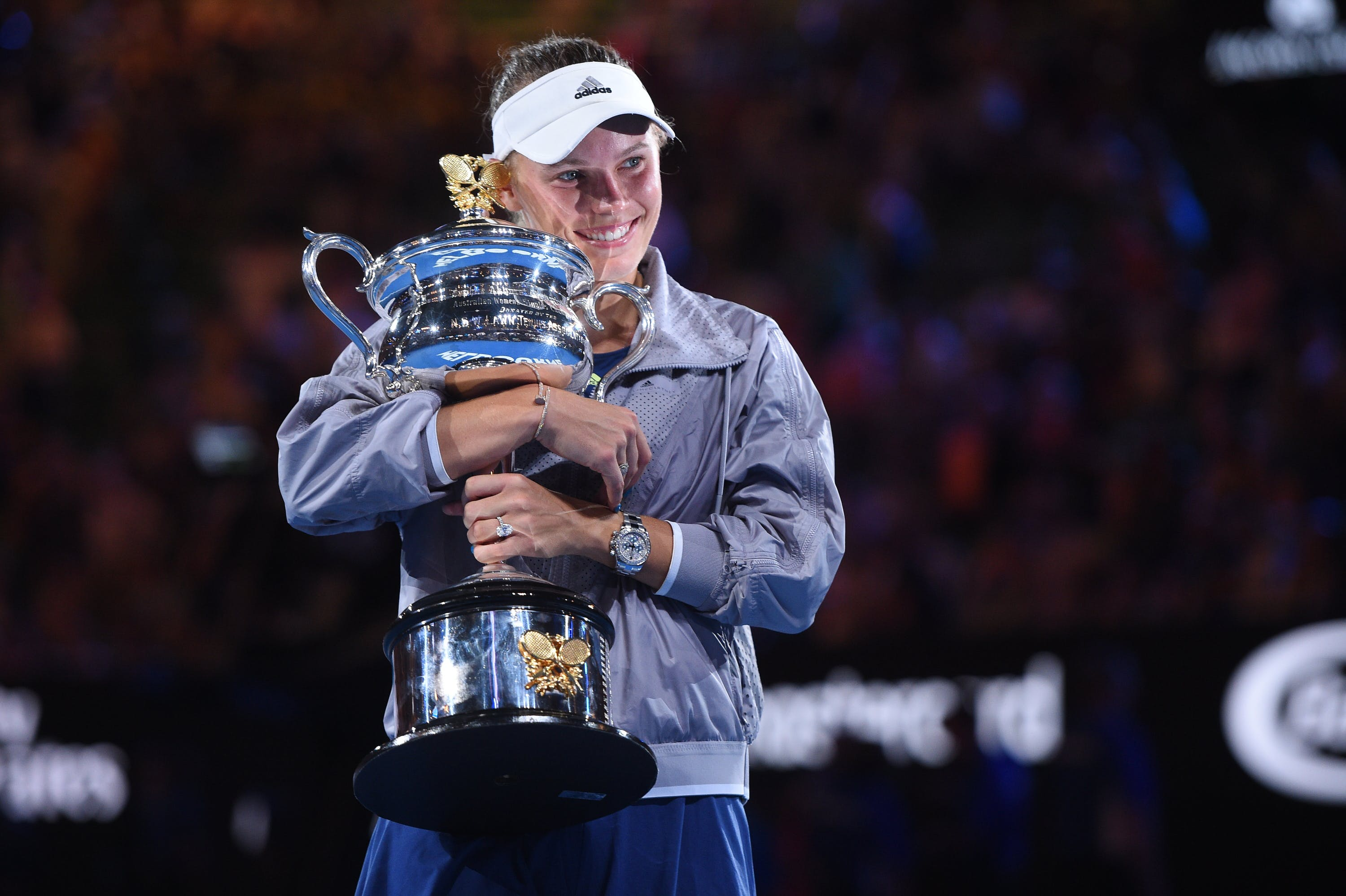 Caroline Wozniacki smiles and holds the 2018 Australian Open trophy