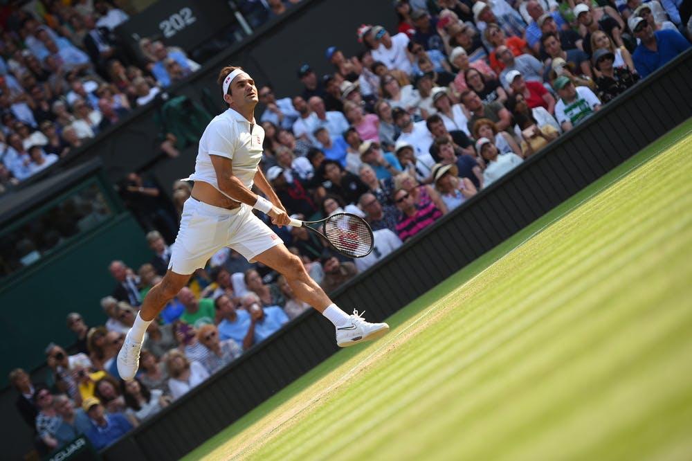 Artistic serving Roger Federer at Wimbledon 2019