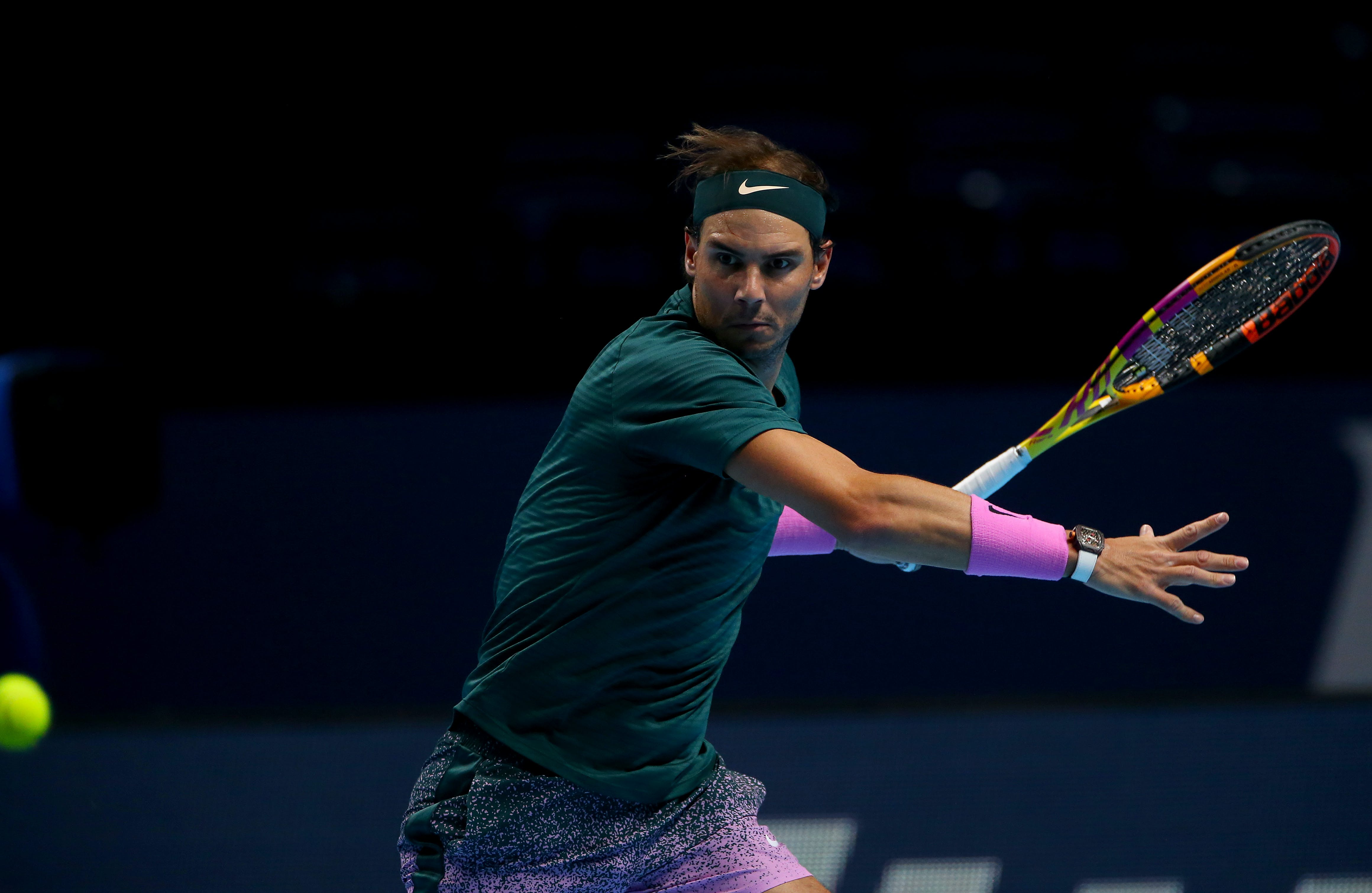 Rafael Nadal about to hit a forehand during his match against Stefanos Tsitsipas during the ATP Finals 2020