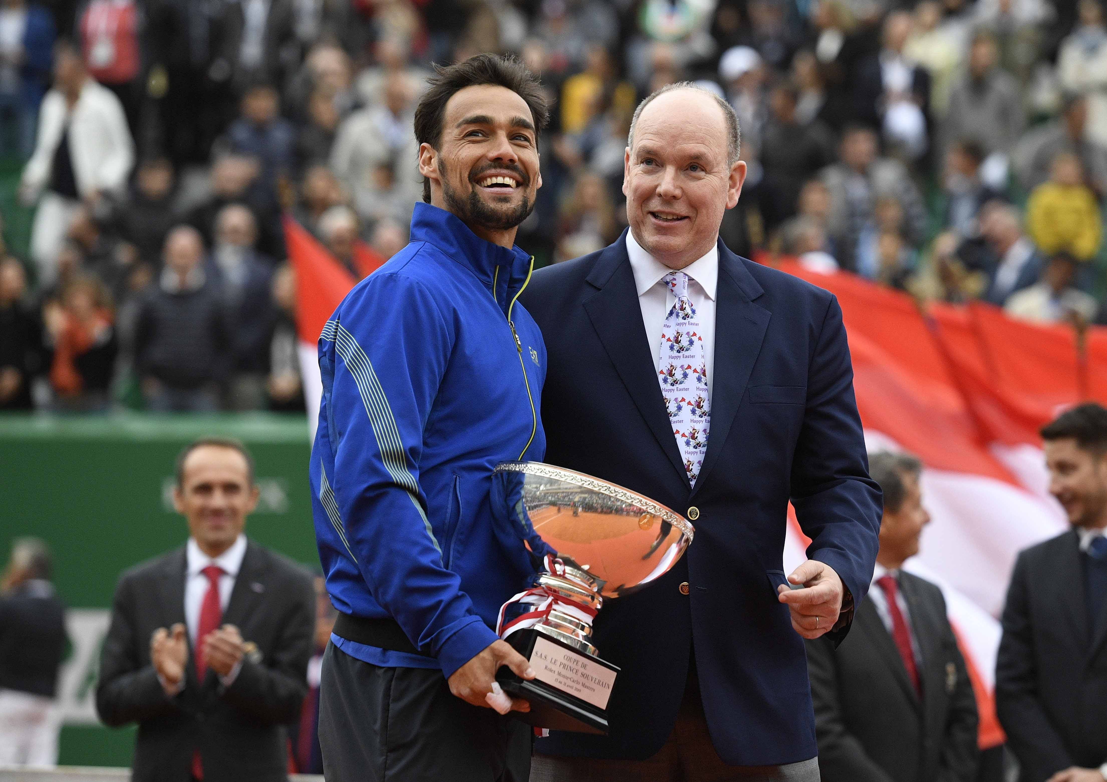 Fabio Fognini poses with his Rolex Monte-Carlo Masters 2019 trophy and Prince Albert of Monaco
