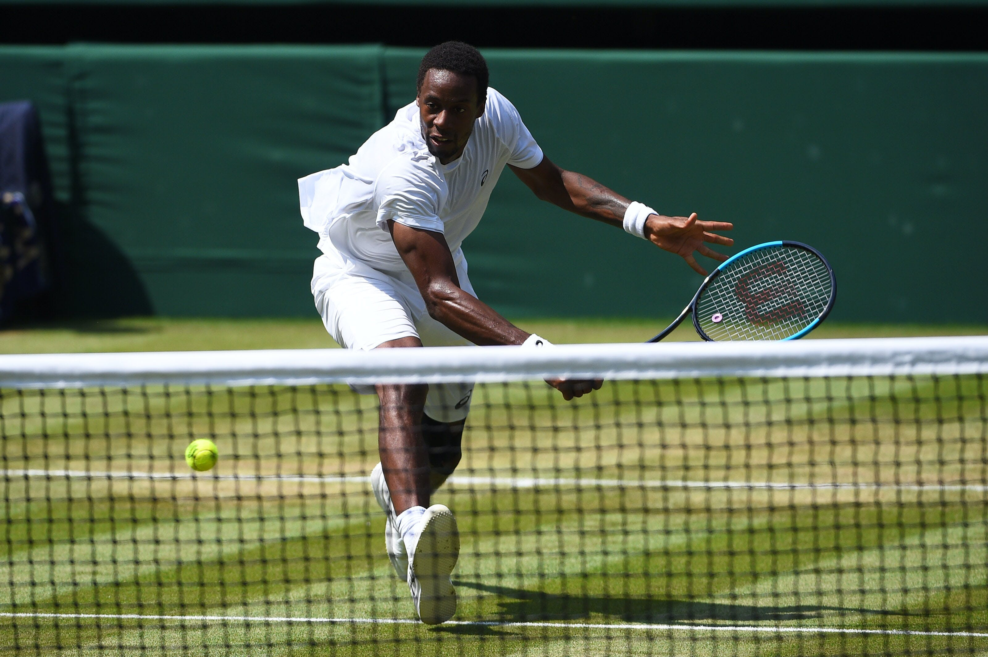 Gaël Monfils comes to the net at Wimbledon 2018.