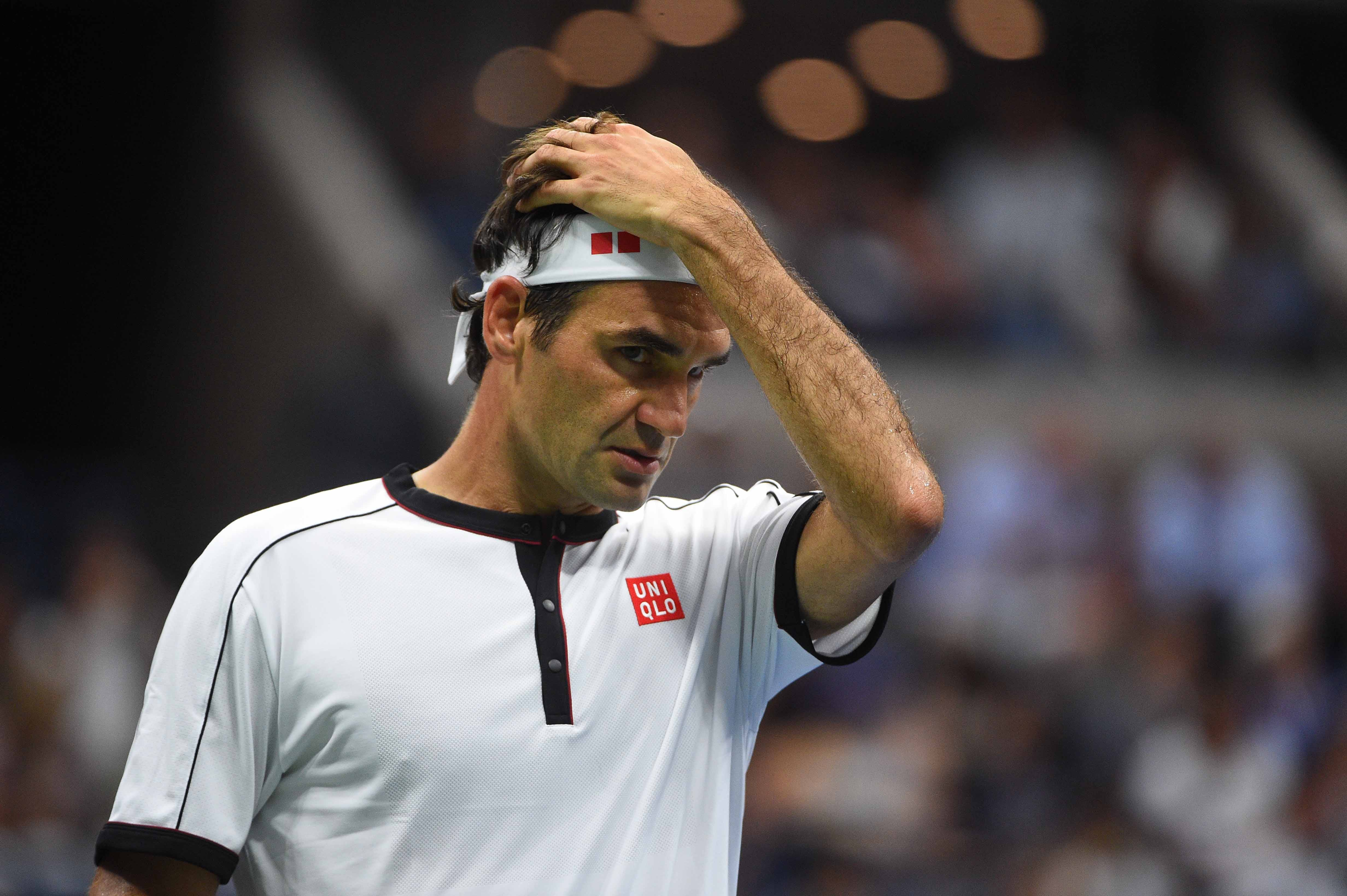 Roger Federer looking concerned durinh his second round match at the 2019 US Open