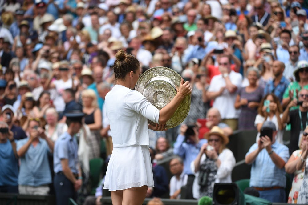 Simona Halep from behind with her trophy at Wimbledon 2019