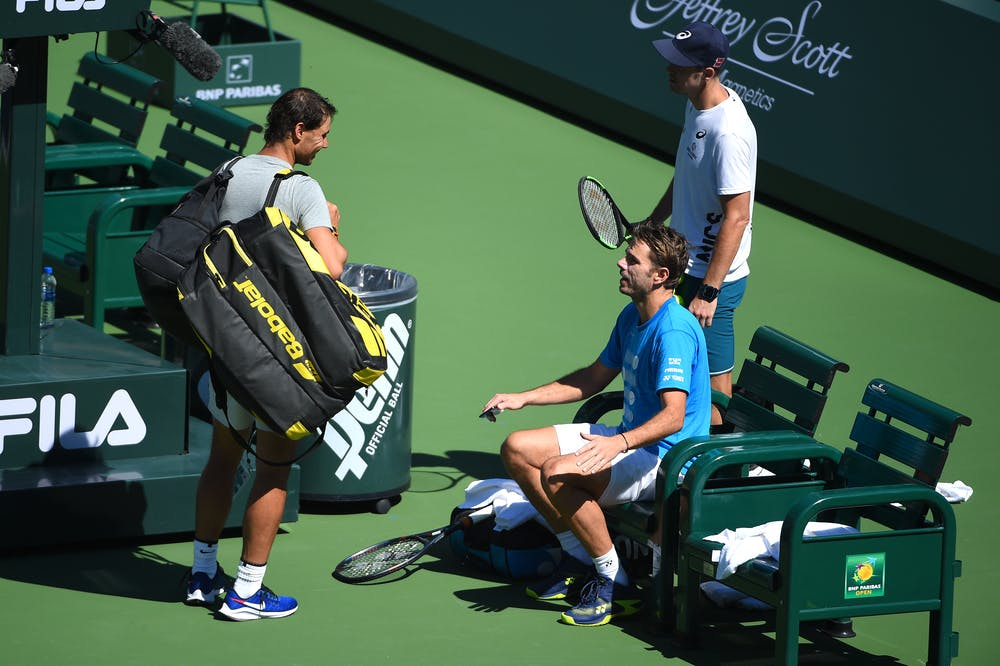 Rafael Nadal and Stan Wawrinka chatting and laughing together in Indian Wells 2019.