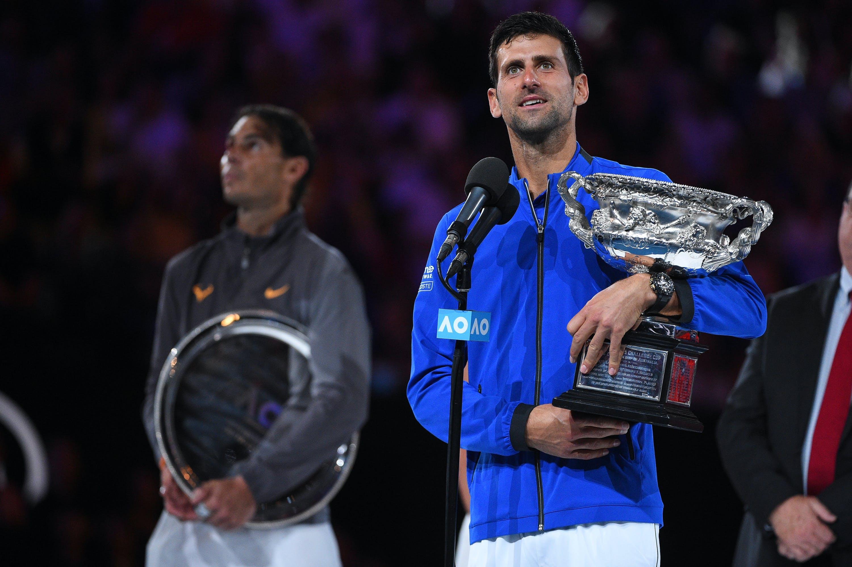 Novak Djokovic and Rafael Nadal on the podium during the trophy presentation at the 2019 Australian Open