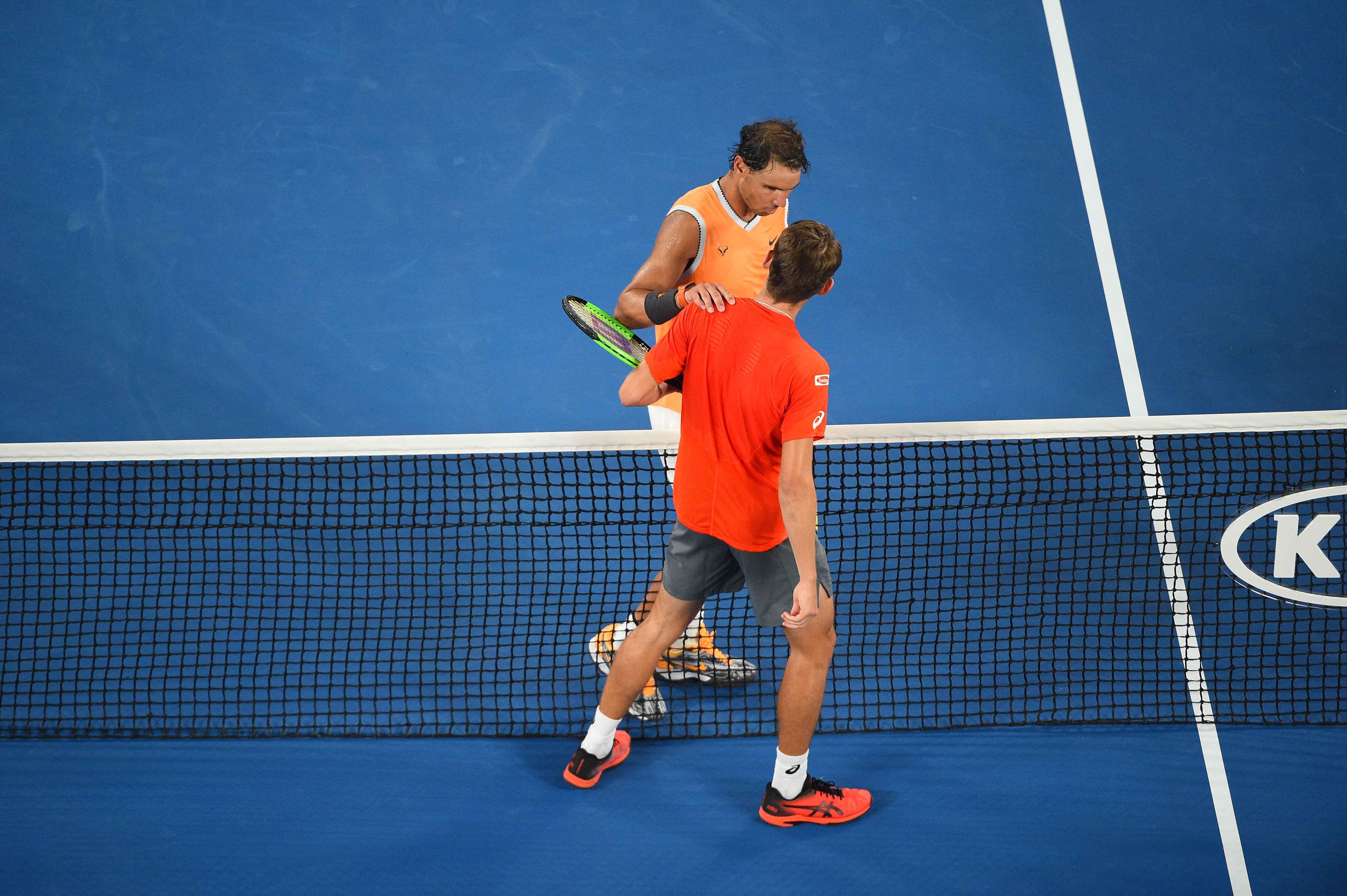 Rafael Nadal and Alex de Minaur at the net Australian Open 2019