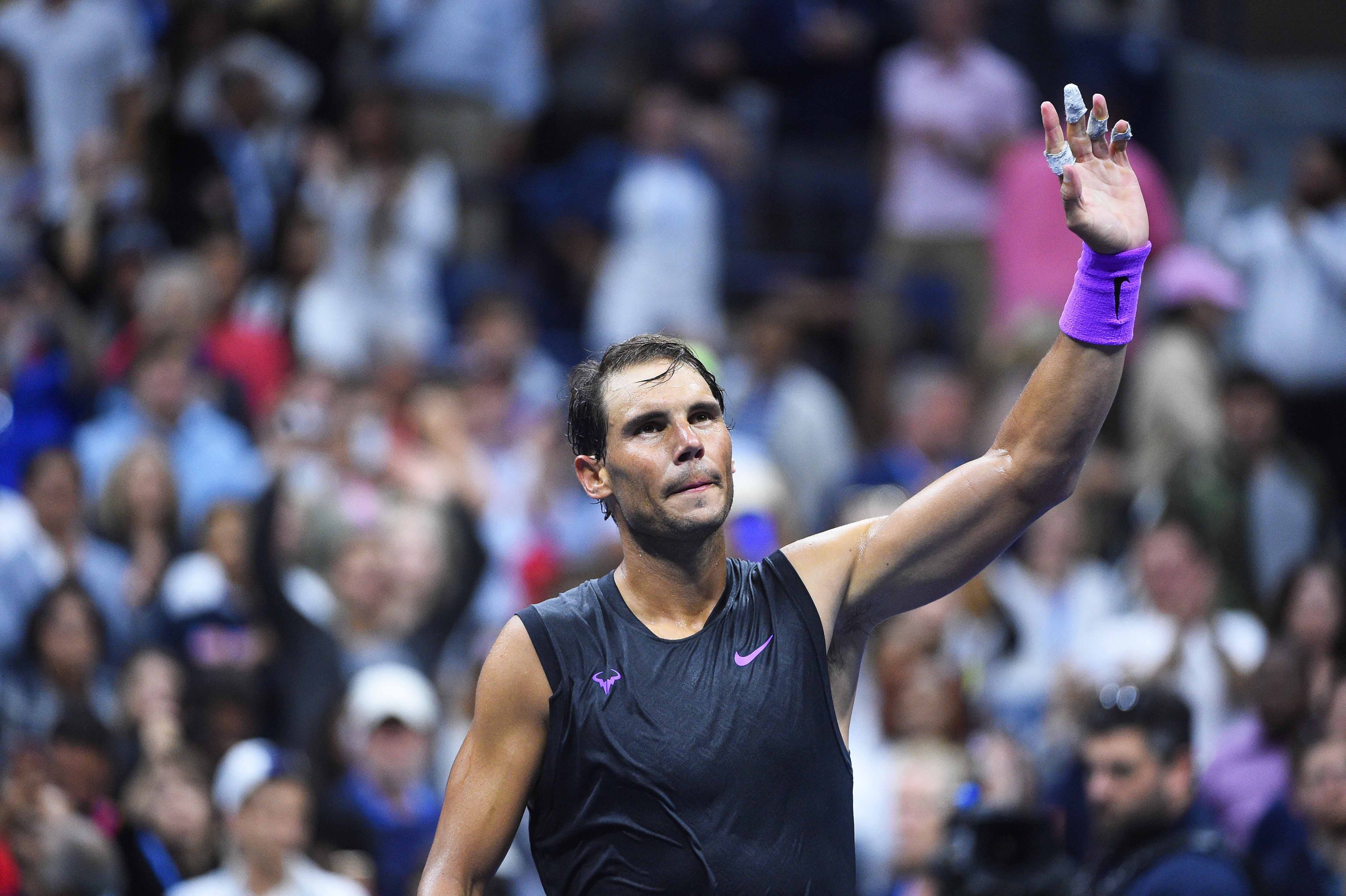 Rafael Nadal wawing to the crowd after his first round match at the 2019 US Open