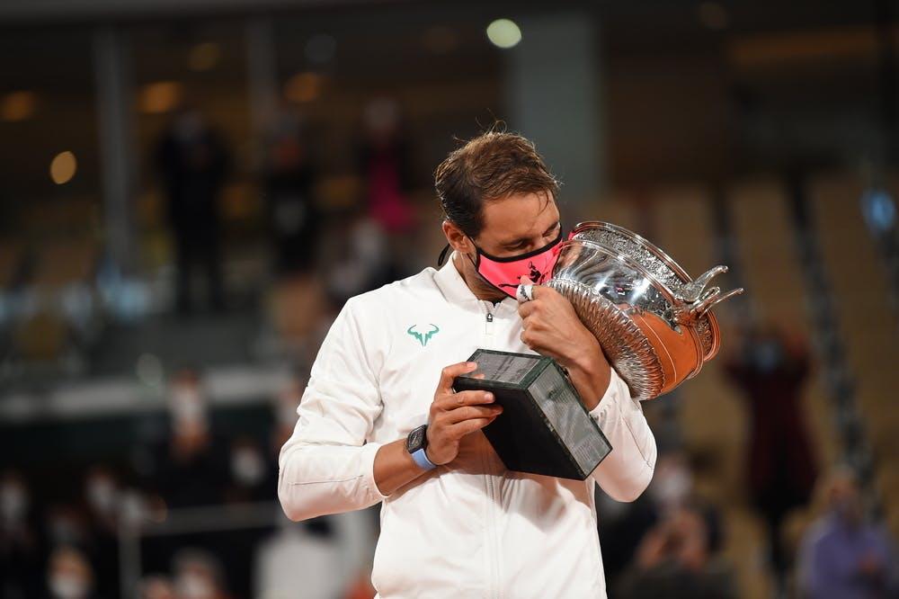 Rafael Nadal kissing his Roland-Garros 2020 trophy