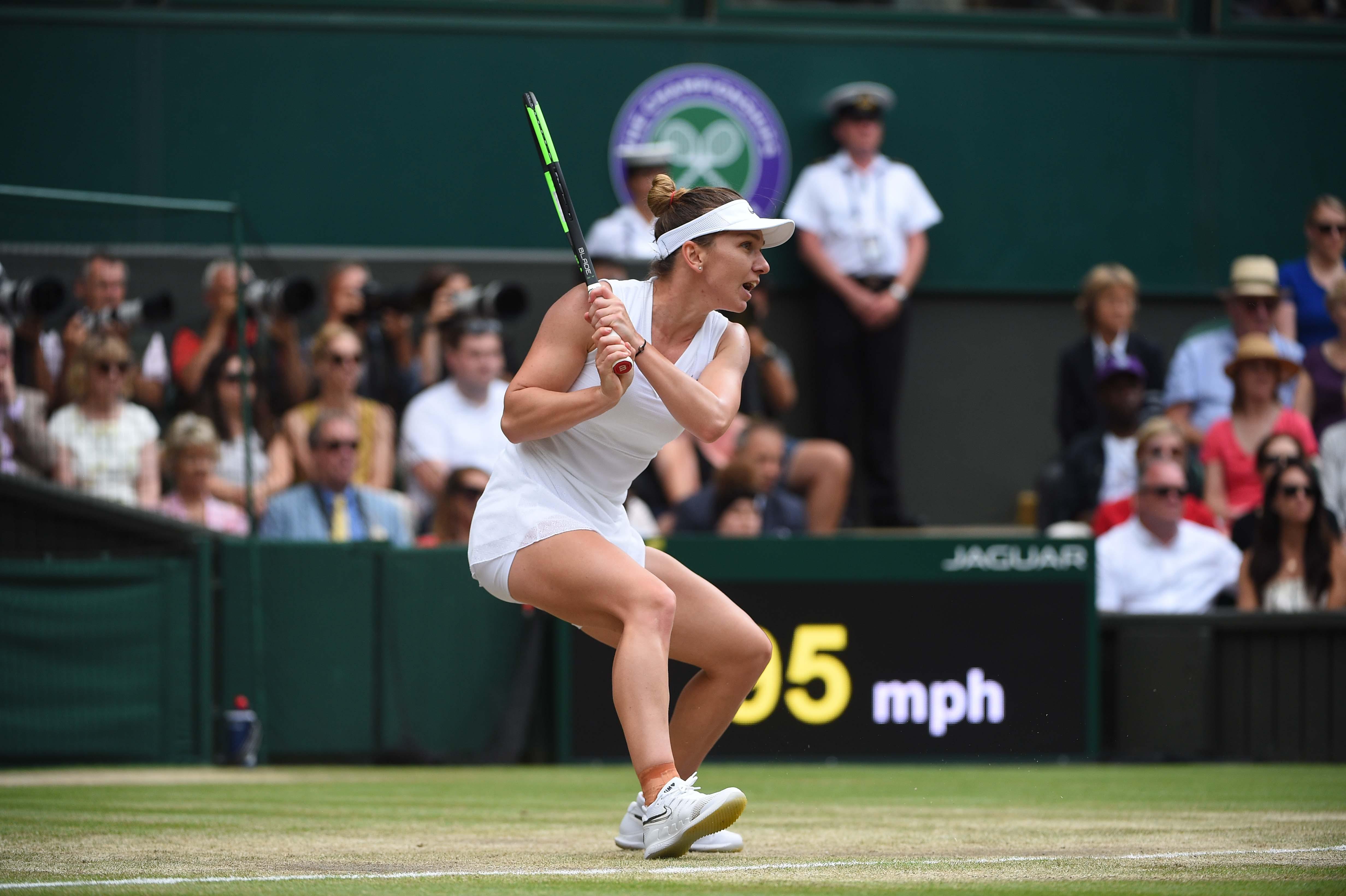 Simona Halep hitting a backhand during her Wimbledon 2019 final
