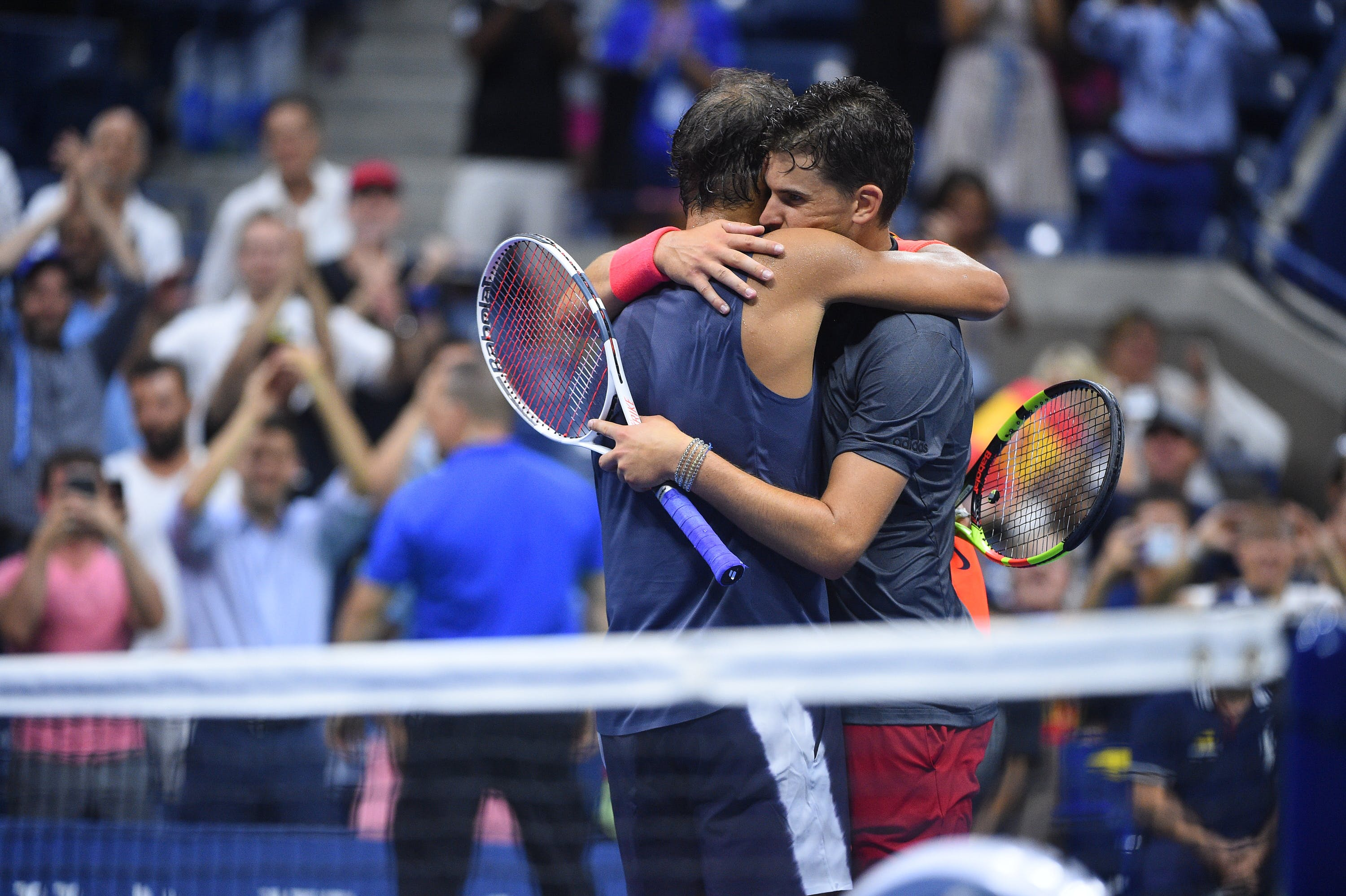 Rafael Nadal and Dominic Thiem hugging at the 2018 US Open