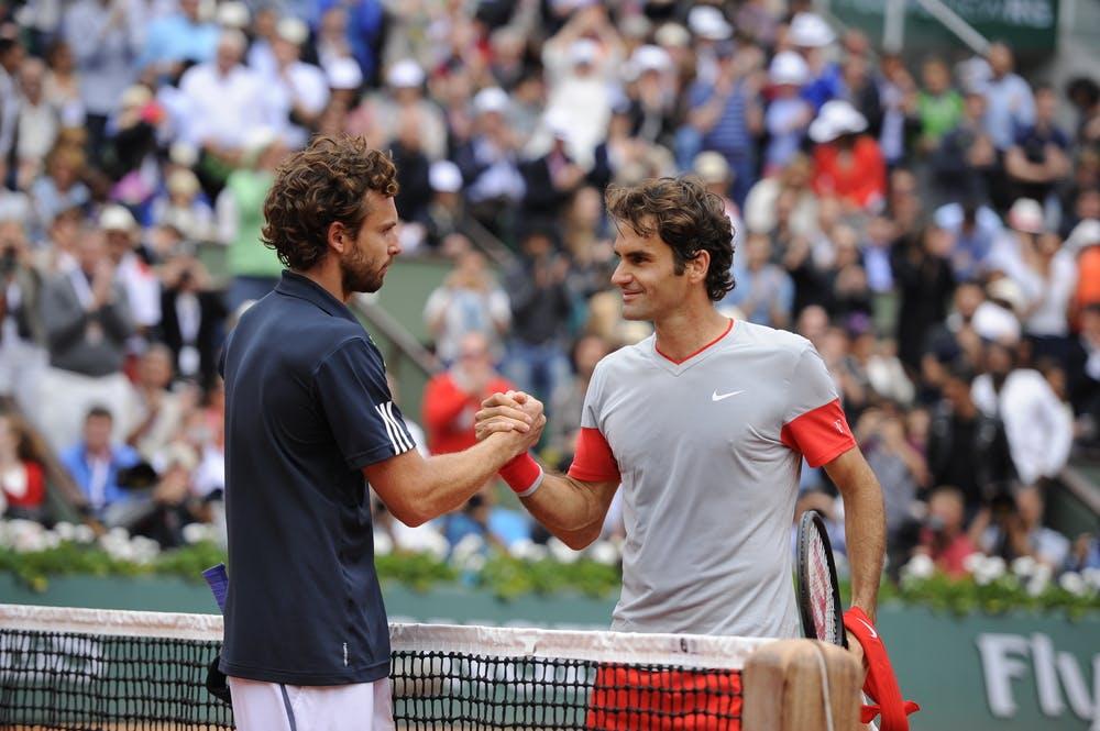 Ernests Gulbis et Roger Federer